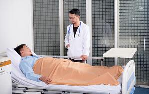 doctor checking on patient with heat-stroke