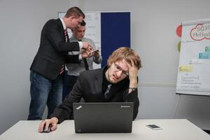 business laptop stressed password security cyber insurance