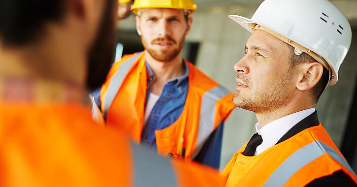 construction company workers discussing safety