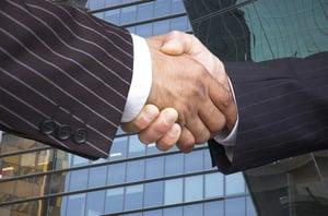 Persons handshake
