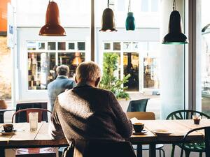 Old man sitting at a coffee